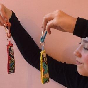 Girl holding hand sewn carabiner keyrings